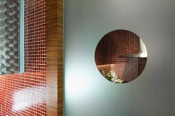 Architectural detail mosaic tile wall and frosted glass window