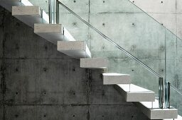 Concrete floating stairs with glass railing