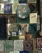 Wall plates on vintage tiled stove