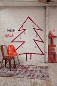 Retro chairs in front of Christmas tree sketched on wall in rustic interior