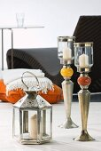 Oriental lantern and silver-plated brass candlesticks