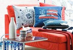 Red chaise armchair with maritime scatter cushions