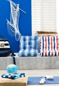 Interior with maritime decor, marble bench & striped seat cushions
