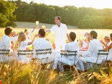 Group of people having dinner, sunset