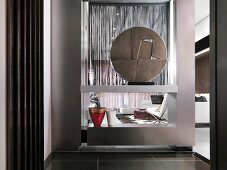 Decorative art object on modern shelving serving as a room divider in an open living room