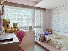Modern child's room with a bed in front of a window with a see-through curtain