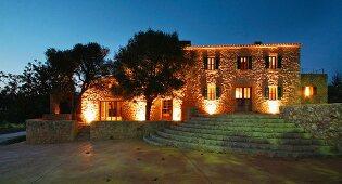 Front exterior Spanish villa at dusk