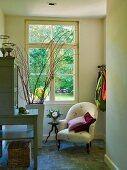 Armchair in corner below window