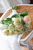 Arrangement of roses and gypsophila