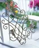 Vintage, metal wall candle sconce on a chair