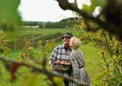 Woman kissing man in garden
