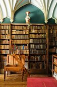 Antique library with library ladder and ecclesiastical, Gothic vaulted ceiling