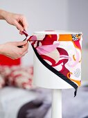 Decorating a white table lamp in 70s colours with a scarf