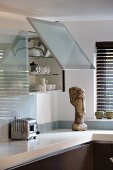 Kitchen wall unit with open lift-up door in frosted glass