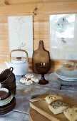 Table set with teapot, pastries and stacked tea set
