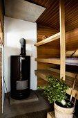 Finnish sauna with large stove and sauna utensils