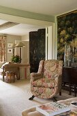 Paisley upholstered armchair with 18th century lacquer screen in home of fabric designer Richard Smith