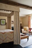 Four poster bed in home of fabric designer Richard Smith in East Sussex