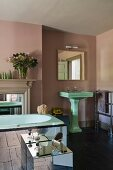 1930s green deco sink and mirrored furniture in home of fabric designer Richard Smith in East Sussex