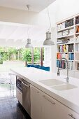 Free-standing kitchen island in front of bookcase