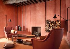 Brick red living room with matching armchairs in front of fireplace