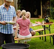 Friends enjoying a barbeque in the garden