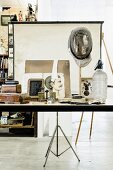 Various vintage ornaments on modern worksurface in front of projector screen