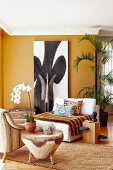 Corner of dark ochre living room with colonial-style lounge chairs