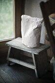 Paper bag on foot stool