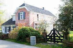 Renovated and extended farmhouse with brick façade and garden