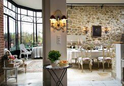 Spacious interior with large bay window, rustic stone wall and elegant furniture
