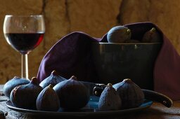 Still-life with fogs, glass of red wind and Laguiole knife