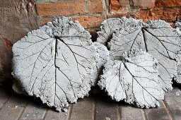 Concrete stepping stones made using rhubarb leaves as templates