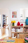 Storage baskets in wooden shelving unit in bright interior