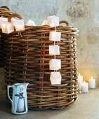 String of fairy lights, wicker basket & small china jug in Château Maignaut (Pyrenees, France)