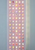 Modern, flat light sculpture with dots of light