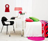 Colourful pillows and bedspread in white bedroom