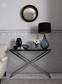Lamp and vases on side table in living room