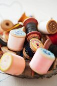 Old wooden reels of thread
