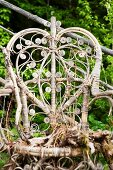 Old, partially rotted wicker chair in garden