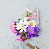 Posy of garden flowers on vintage shelf