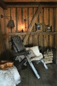 Animal-skin rug on rustic wooden chair in wooden cabin