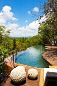 Wooden terrace with curved pool and fabulous view across landscape