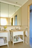 Bright bathroom with separate wash stands and mirrored bathroom cabinet