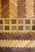 Various patterns of parquet flooring in varnished wood