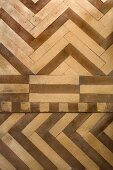Various patterns of varnished parquet flooring in contrasting shades