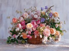 Summer bouquet of old roses, English roses, honeysuckle, campanula, ornamental grass and love-in-a-mist