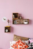 Box shelves with patterned back walls can be hand-crafted using wallpaper offcuts or painted