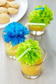 Drinking straws decorated with tissue paper pompoms