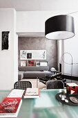 Modern, open-plan interior with designer furniture and calligraphy on walls